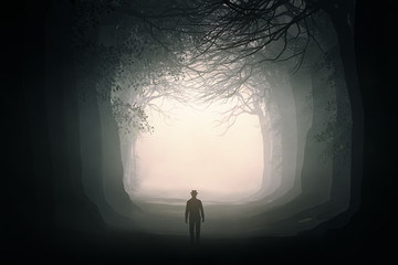 man walking in a dark forest