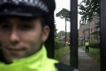 Police personnel stand outside the Jameah Islamiyah Secondary School in Mark Cross in East Sussex