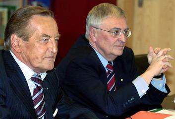 President of German Soccer Association DFB Mayer-Vorfelder and co-president Zwanziger await the ...
