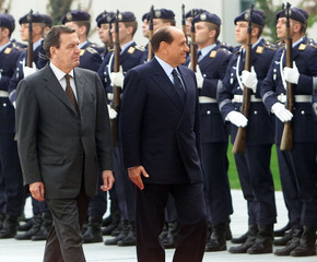 GERMAN CHANCELLOR SCHROEDER AND ITALIAN PREMIER BERLUSCONI REVIEWHONOUR GUARD IN BERLIN.