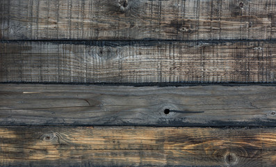 Black wood background, charred planks, painted black stain