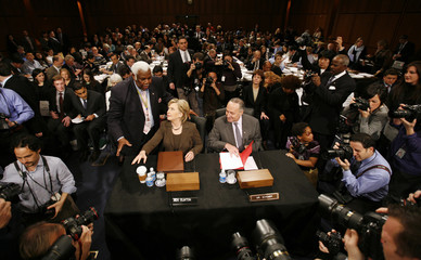Hillary Clinton testifies during her confirmation hearing on Capitol Hill in Washington