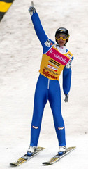 AUSTRIA'S HOELLWARTH CELEBRATES HIS SECOND PLACE IN THE SKI JUMPCOMPETITON IN OBERSTDORF.