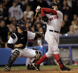 Boston Red Sox Jason Varitek hits a home run in Game 1 of the American League Championship Series at ...