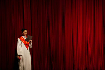 A choir member from the protestant Nanjing Christian Church reads her hymnal during a Christmas function in Nanjing