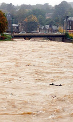 Heavy rain raises the level of the river Teviot in the borders town of Hawick in Scotland
