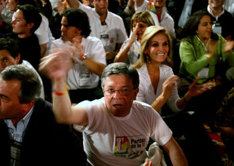 Colombian President Alvaro Uribe's supporters celebrate his victory in Colombia's presidential elections in Bogota
