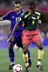 CAMEROON'S ETO'O FIS FENDS OFF KUWAIT'S ALBURAIKI IN BRISBANE.