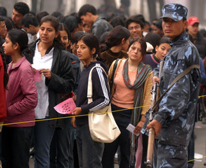 NEPALESE POLICE STANDS GUARD AS STUDENTS VOTE AT TRICHANDRA CAMPUS IN KATHMANDU.