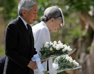 Japan's Emperor Akihito and Empress Michiko lay flowers for war dead in Saipan.