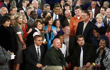 U.S. Democratic presidential nominee Obama poses with audience members after presidential debate in Nashville