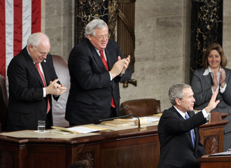 US President Bush waves after his State of the Union address in Washington