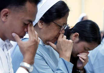 Indonesian nun attends mass to pray for victims of quake and the Pope in Nias.