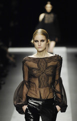 A model presents a creation by Italian designer Riccardo Tisci for French fashion house Givenchy as part of his Fall/Winter 2008/09 women's ready-to-wear fashion show in Paris