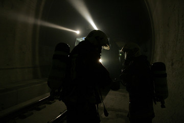 Firefighters take part in an emergency exercise in the new Loetschberg tunnel in Mittholz