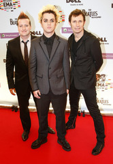 US rock band Green Day pose the red carpet before the MTV Europe Awards ceremony in Berlin