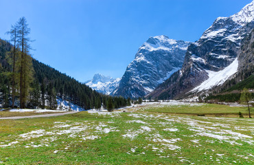 Wall Mural - Spring mountain landscape with patches of melting snow. Austria, Tyrol, Karwendel Alpine Park