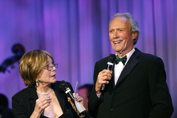 Clint Eastwood smiles next to actress Shirley MacLaine as she presents him with the Lifetime Achievement Award at the 53rd annual Thalians gala in Beverly Hills