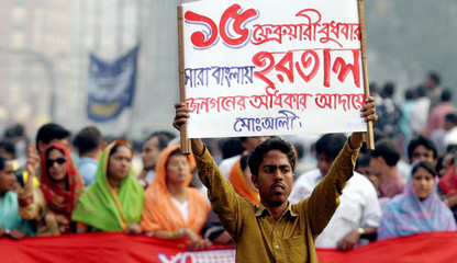 Activist carries a placard during an opposition march in Dhaka