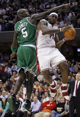 Cavaliers James puts up a shot around the defense of Celtics Garnett in the second half of their NBA game in Cleveland