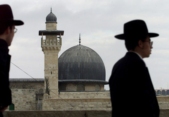 ORTHODOX JEWS PASS THE AL-AQSA MOSQUE IN THE OLD CITY IN JERUSALEM.