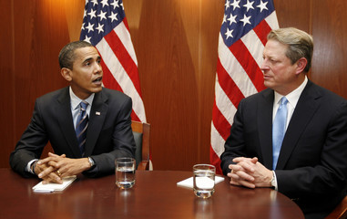U.S. President-elect Obama speaks during a meeting with former Vice President Gore in Obama's transition office in Chicago