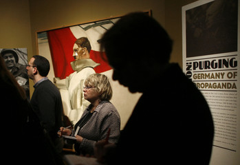 "Visitors tour ""State of Deception: The Power of Nazi Propaganda"" at the National Holocaust Memorial Museum in Washington"