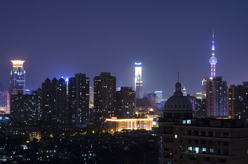 Beautiful bright night scape lights and clear sky view of Shanghai's downtown skyline. Pudong district, Shanghai China, Asia.