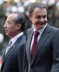 Mexico's President Felipe Calderon and Spain's Prime Minister Jose Luis Rodriguez Zapatero smiles during an official welcoming ceremony in Mexico City's National Palace