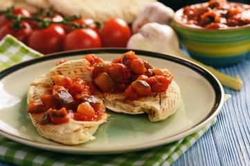 Pita bread with vegetable spread- mediterranean kitchen style.