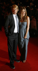 """U.S. actors Owen Wilson  and Jennifer Aniston pose for photographers as they arrive for the British premiere of """"Marley & Me"""" at Leicester Square in London"""