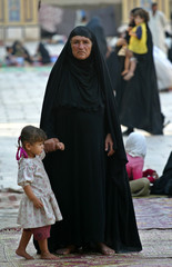 Refugees from the restive Iraqi city of Najaf wander the grounds of a mosque where hundreds sought shelter.