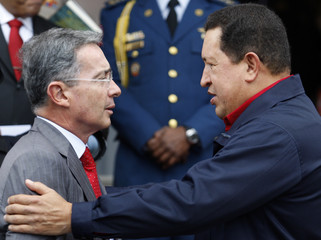 Venezuelan President Chavez welcomes Colombian counterpart Uribe at Miraflores Palace in Caracas
