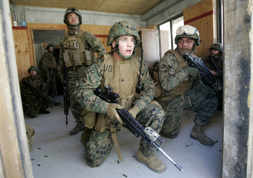 Marines from the U.S. and South Korea equipped with MILES take part in a Force-on-Force military operation on urban terrain at the U.S. army's Rodriguez range in Pocheon