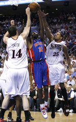 Detroit Pistons guard Hamilton shoots between the defense of the Philadelphia 76ers during their NBA basketball playoff series in Philadelphia