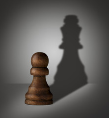 chess pawn with shadow shaped as a king