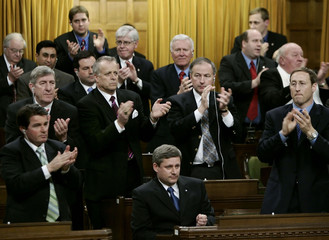 Conservative party leader Stephen Harper is applauded in the House of Commons.