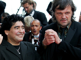 Former Argentine footballer Diego Maradona poses on red carpet before awards ceremony at 58th Cannes ...