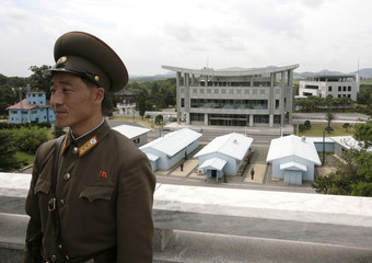 BEST QUALITY AVAILABLE    A North Korean soldier stands on a terrace overlooking the truce village of Panmunjom