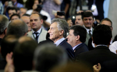 Paraguayan President Cartes and Argentinian President Macri arrive before signing a document that establishes a nearly 80 percent reduction of the debt of the hydroelectric dam Yacyreta, in Ayolas