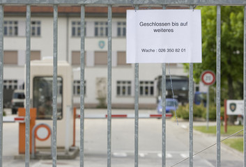 A sign is seen outside the closed army base la Poya in Fribourg