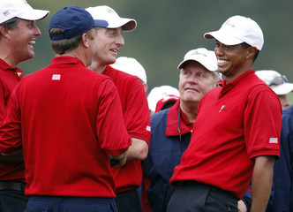Tiger Woods, Jim Furyk, Phil Mickelson and Jack Nicklaus of U.S. team after first round at the President's Cup golf tournament