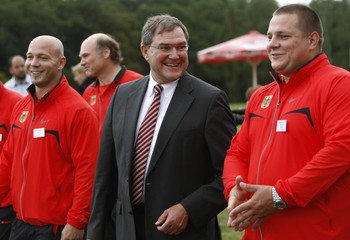 German Defence Minister Jung talks to shot-putter Bartels and hammer thrower Esser at the German national sports training centre in Kienbaum