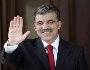 President-elect Abdullah Gul waves after he received his official election document in Ankara