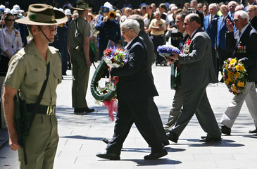 People honouring Australian soldiers pass a ceremonial sentry before placing wreaths at the Cenotaph in Sydney