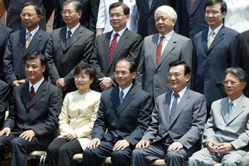 TAIWAN PREMIER YU SHYI-KUN AND HIS CABINET MEMBERS POSE FOR A GROUP PICTURE IN TAIPEI.
