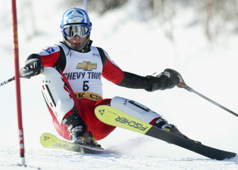 SCHOENFELDER OF AUSTRIA CRASHES IN FIRST HEAT OF SLALOM.