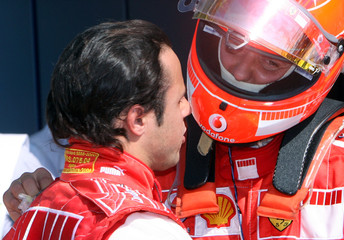 Schumacher of Germany talks with his team mate Massa of Brazil after the pole position race at the Monza
