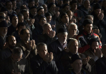 Iranian worshippers pray during Eid al-Adha prayers at a university in Tehran