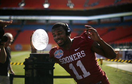 University of Oklahoma defender Holmes poses for pictures with the national championship trophy during media day at the Dolphins stadium in Miami